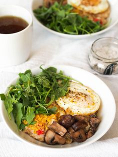 Hopping on the savory oatmeal trend with this bowl of oats topped with sauteed mushrooms, arugula and a fried egg!
