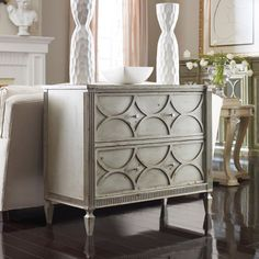 """Crownpoint Chest was composed by trained artisans and craftsmen to be the perfect marriage of function and style. The modern detailing on the drawers, soft neutral hue, and minimalist hardware yield a piece perfect for your downtown loft or Cape Cod retreat.    Construction Material: Maple  Finish: Soft gray and blue with golden undertones  Features: 2 Drawers  Collection: Habersham American Treasures  Size: 36"""" H x 43"""" W x 21"""" D  Note: Finish is antiqued which means that it may include rub…"""