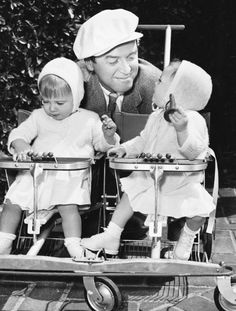 James Stewart with his twin daughters in 1953.