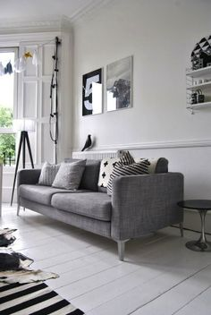 white floor, gray sofa...