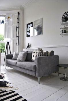 white floor, gray sofa...