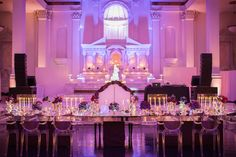 Head Table with Ghost Chairs & Bench | Photography: KLK Photography. Read More: http://www.insideweddings.com/weddings/greek-orthodox-church-ceremony-glamorous-purple-gold-reception/730/