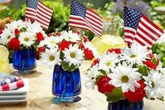 4th of July centerpiece using red and white flowers and blue food coloring in the water, or just just red, white and blue flowers in a Mason jar and add a small flag