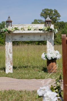 Vintage mantel with lanterns, nail keg with flowers, and braided rug. www.facebook.com/cabincreekantiques www.lizphotography.com vintage wedding rentals