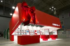 What's in the box? Great exhibition stand design - good use of colour and lighting.