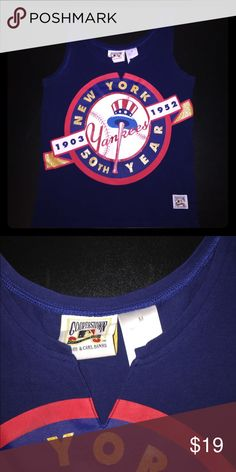 New York Yankees Cooperstown Collection 50th Tank For sale is a size Medium, women's MLB New York Yankees Cooperstown Collection 50th Anniversary Tank Top. Top is navy blue and features the Large glitter incorporated font 50 Year Logo across the chest. A must have for the fan of the leading team in World Series victories, Yankees! MLB Tops