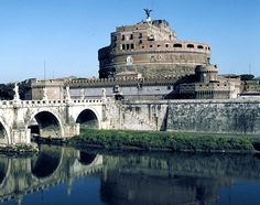 Castel Sant Angelo -- Originally built as a tomb for Emperor Hadrian but converted into a fortress by the Renaissance popes.  Also has a sinister side as it is notorious for  its courtyards which were the scene of executions by decapitation and the heads of the condemned were then hung for days along the bridge as a terrible warning.