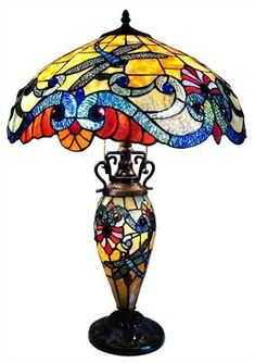 This Tiffany Style Dragonfly design double lit table lamp will compliment many decors throughout the home and provide years of satisfaction. This Tiffany-glass table lamp is crafted with 521 pieces of glass and 67 cabochons. Louis Comfort Tiffany, Stained Glass Table Lamps, Metal Table Lamps, Lamp Table, Desk Lamp, Table Desk, Antique Lamps, Vintage Lamps, Dragonfly Stained Glass