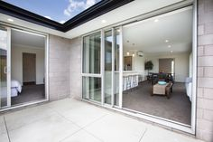 Indoor outdoor flow is a great way to improve your home's potential. This show home has large sliders off the family room onto a large patio - perfect spot for summer BBQs. Indoor Outdoor, Outdoor Living, 4 Bedroom House Plans, Home Board, Sliders, Flow, Family Room, New Homes, How To Plan