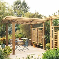 Pergola with privacy wall.  Perfect for hiding the dog run from the patio.