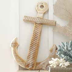 Seaside Anchor Decor | Add texture to a nautical collage or add the perfect finishing touch to the guest room with this rustic anchor decor, crafted from wood and showcasing weathered details.