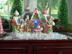 H201121 Lit Gingerbread Town has a whimsical look and runs on a timer.  http://qvc.co/-Shop-ValerieParrHill