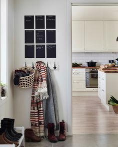 Make mini chalkboard out of black cards right beside the door for important reminders. (Checker- board is less dominant than a blackboard painted wall & easier to change.)Add a handy Ikea GADDIS grab basket below for your gloves /hats & shoes below.