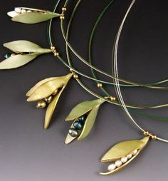 These pendants by Judy Dunn are beautiful examples of the revealing stage of a pod and featured on The Polymer Arts magazine's blog.