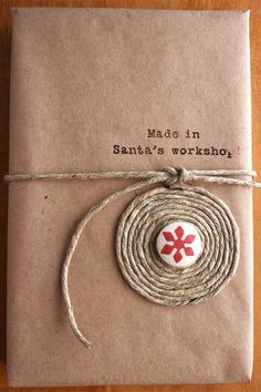 Coil your twine into a circle. A simple Cheer Canvas brad in the center…