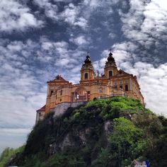 This Benedictine abbey sits above Melk, Austria, and overlooks the beautiful…