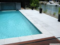 Light Grey Granite Pool Tiles and Pavers. Outdoor Pavers and Coping Light Grey Granite Pool Tiles an Pool Paving, Outdoor Pavers, Outdoor Tiles, Pool Landscaping, Outdoor Pool, Grey Paving, Pool Coping Tiles, Swimming Pool Tiles, Small Backyard Pools