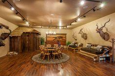 Inspiration venue de la chasse, ce salon rustique reflète la passion de ses propriétaires