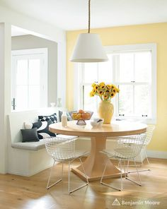 It's hard to resist this kitchen accent in Benjamin Moore's Hawthorne Yellow. It works well with all of the white trim, ceilings and the white banquette and chairs. And the lemons and sunflowers! Photo: courtesy of Benjamin Moore. Kitchen Paint Colors, Room Paint Colors, Paint Colors For Home, Bedroom Colors, Yellow Kitchen Walls, Yellow Walls Living Room, Yellow Rooms, Yellow Dining Room Paint, Yellow Painted Rooms