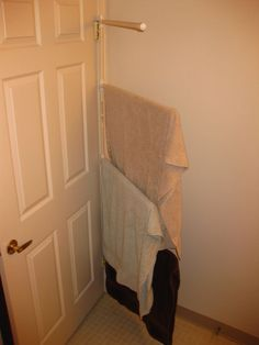 Hang towels and things on the back of your door. | 23 Hacks For Your Tiny Bedroom