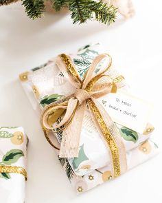 Gift packaging and wrapping | gold layered ribbon bow, gift tag and Christmas wrapping paper