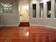 Mesmerizing Glossy Laminate Wood Flooring Idea In Cabernet Finish Installed In Contemporary Room Idea