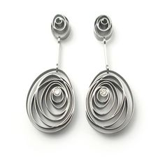 The initial idea for those earrings came from observing the fragile lines of fingerprints