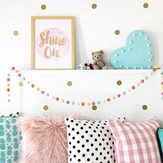 Soph's getting on board the pastel pink train too! Love heart, print & pink fluffy cushion from @kmartaus String of felt baubles from @adairs kids, pink check cushion cover, feather insert & shelf from @ikea_australia (link in profile for blog post about that funny shopping experience), gold polka dot wall decals from @pineappletraders B&W polka dot cushions from @freedom_australia (not current) Aqua pineapple cushion from @kerenbrown #hbmystyle #qweekendloves #cornerofmyhome #pastelpink