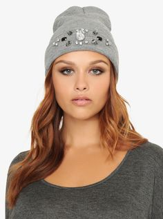Add a little sparkle to your look with this heather grey knit beanie that has a flipped up brim adorned with clear, smokey and black gemstones,