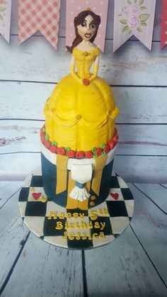 Belle and Beast birthday cake. Checked board, 2 tier, chocolate and jam sponge mmm. Happy birthday Jessica 🎂❤