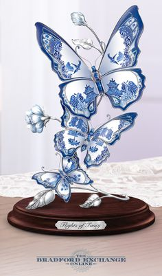 Limited edition. True love is honored in this porcelain Blue Willow butterfly sculpture with platinum edging and glass jewels.