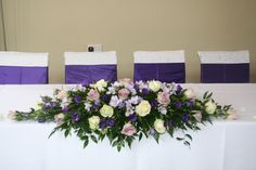 Gorgeous Cadbury Purple Theme Wedding - Top Table Swag with beautiful flowers.