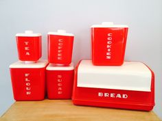 Mid Century Red and White Lustro Ware Kitchen Canister Set and Bread Box - 6 Pieces by DelveChicago on Etsy https://www.etsy.com/listing/292461215/mid-century-red-and-white-lustro-ware