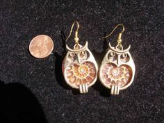Earrings, ammonite fossils, bronze owl  frames  Harry Potter, Winnie the Pooh, Pogo   WWWG, paganteam, OlympiaEtsy, FunkyAlternativeJewelry. $25.00, via Etsy.
