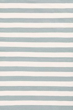 If solid walls- stripe on rug? DashAndAlbert Trimaran Stripe Light- this one is a little too blue though...
