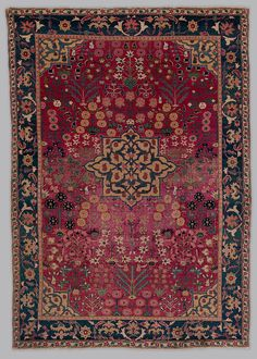 Vase Carpet Object Name: Carpet  Date: 17th century  Geography: Made in Iran, probably Kirman  Medium: Cotton (warp), silk (weft), wool (weft and pile); asymmetrically knotted pile  Dimensions: Rug: H. 81 3/4 in.