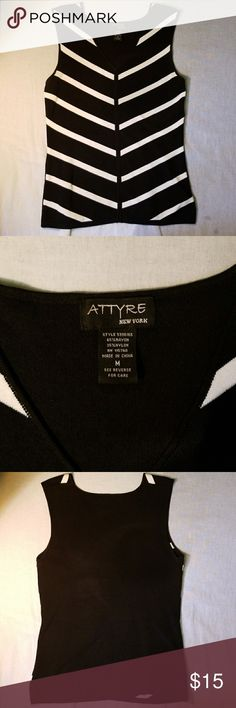 Attyre New York Shirt This is a very cute shirt for the work place. It's made of 65% rayon and 35% nylon. It is a v neck shirt. Attyre Tops
