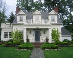 Churchill Cottage, dormers, white with white trim, brick...