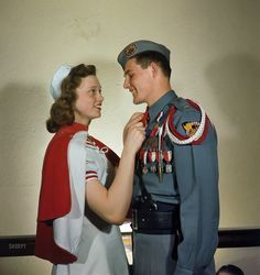 """1948. Mooseheart, Illinois. """"Activities at Mooseheart orphanage. High school boy and girl in their Cadet Corps uniforms."""" And their chaperone. Kodachrome by Stanley Kubrick for Look magazine."""
