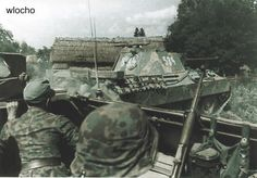 """5th SS-Panzer-Division """"Wiking"""" in Poland. Troops in a halftrack follow a German Panther tank into combat...."""