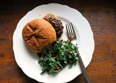 turkey burger with kale salad and pomegranates