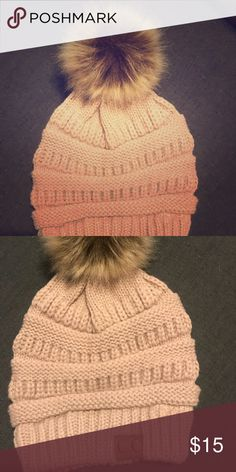NWT - Cable knit hat Cable knit, winter hat with faux fur Pom Pom. Hat is darker than pictured. More of a tan/camel color. Accessories Hats