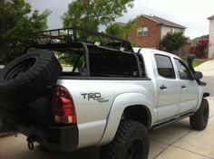 I like the tire rack set at an angle like this. Toyota Trd Pro, Toyota Hilux, Toyota Tacoma, Lifted Tacoma, Tacoma Truck, Hot Rod Trucks, Pickup Trucks, Tactical Truck, Truck Covers