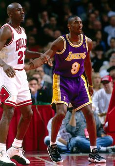 Michael Jordan of the Chicago Bulls stands against Kobe Bryant of the Los Angeles Lakers on December 1996 at the United Center in Chicago, Illinois. Kobe Vs Jordan, Kobe Bryant Michael Jordan, Michael Jordan Basketball, Jordan 23, Kobe Brayant, Air Jordan, Jeffrey Jordan, Kobe Bryant Family, Kobe Bryant Nba