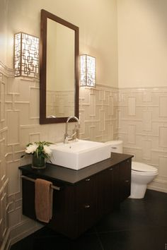 Love this entire design for a powder room: the wall perfectly complements the geometric lamps.