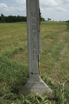 Modern concrete marker for the Mason-Dixon Line.