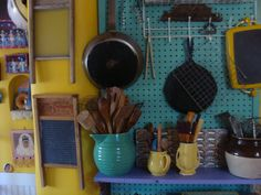 Needed more storage-- added a shelf (leftover fascia board) on the pegboard (salvaged from Singers many years ago) with mismatched cool brackets from Anthropologie (knew I was saving them for something!) Notice washboard collection and kitchen god niche to the left.