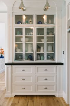 Butler's pantry via House of Turquoise: Four Chairs Furniture | Millhaven Homes