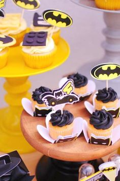 Check out this fun Batman Logo birthday party! The Batman cupcakes are fantastic! See more party ideas and share yours at CatchMyParty.com #catchmyparty #partyideas #batmanparty #legoparty #legobatman #superheroparty #batmancupcakes