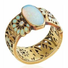 Magical art nouveau opal and diamond ring by Rene Lalique. Part of Beyond Boundaries: Magnificent Jewels from a European Collection; Christies Geneva